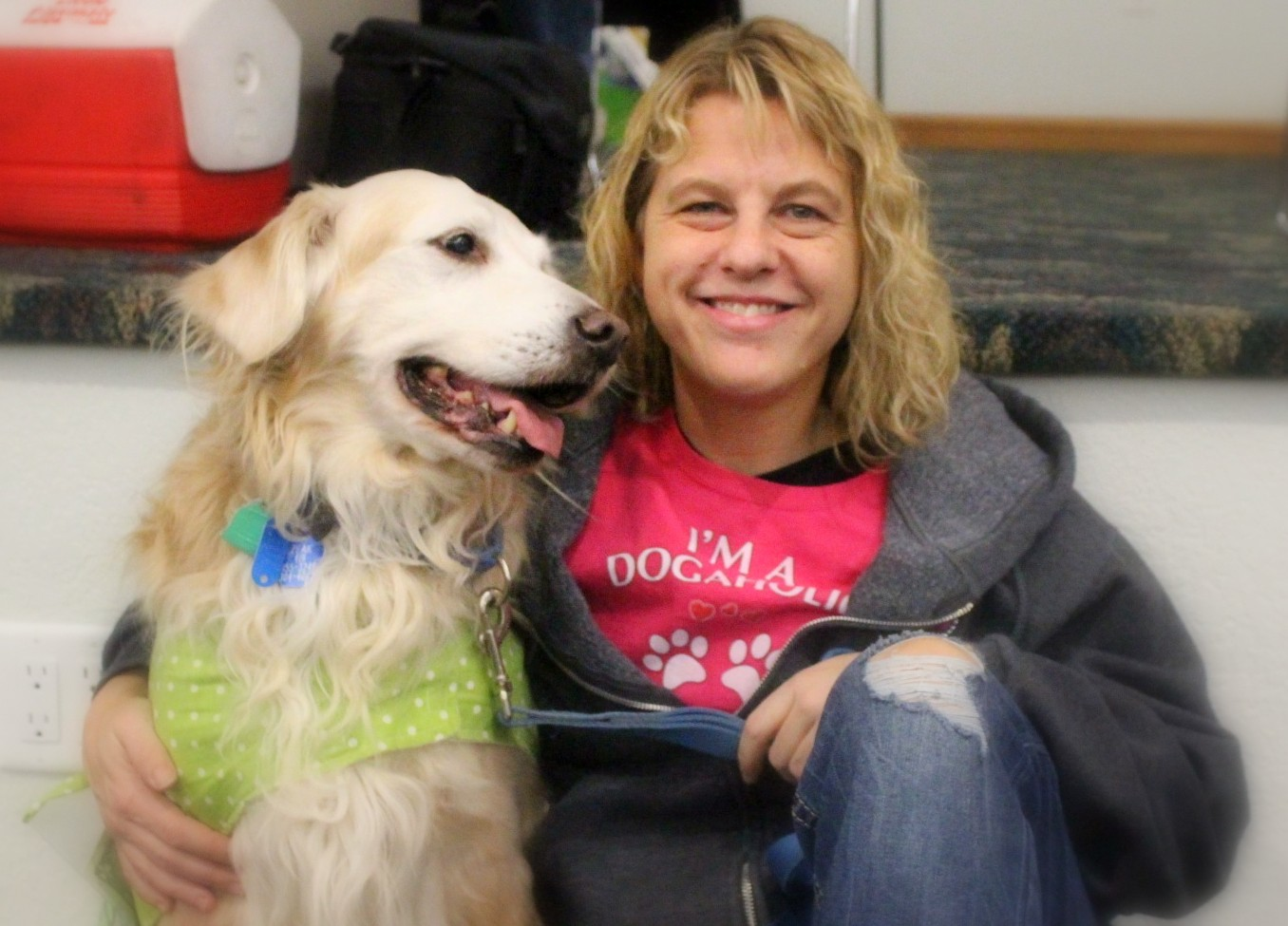 golden retriever dog and foster mom